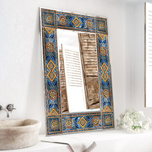 A mirrored frame with desert sand and light ocean blues in a beach design feel.