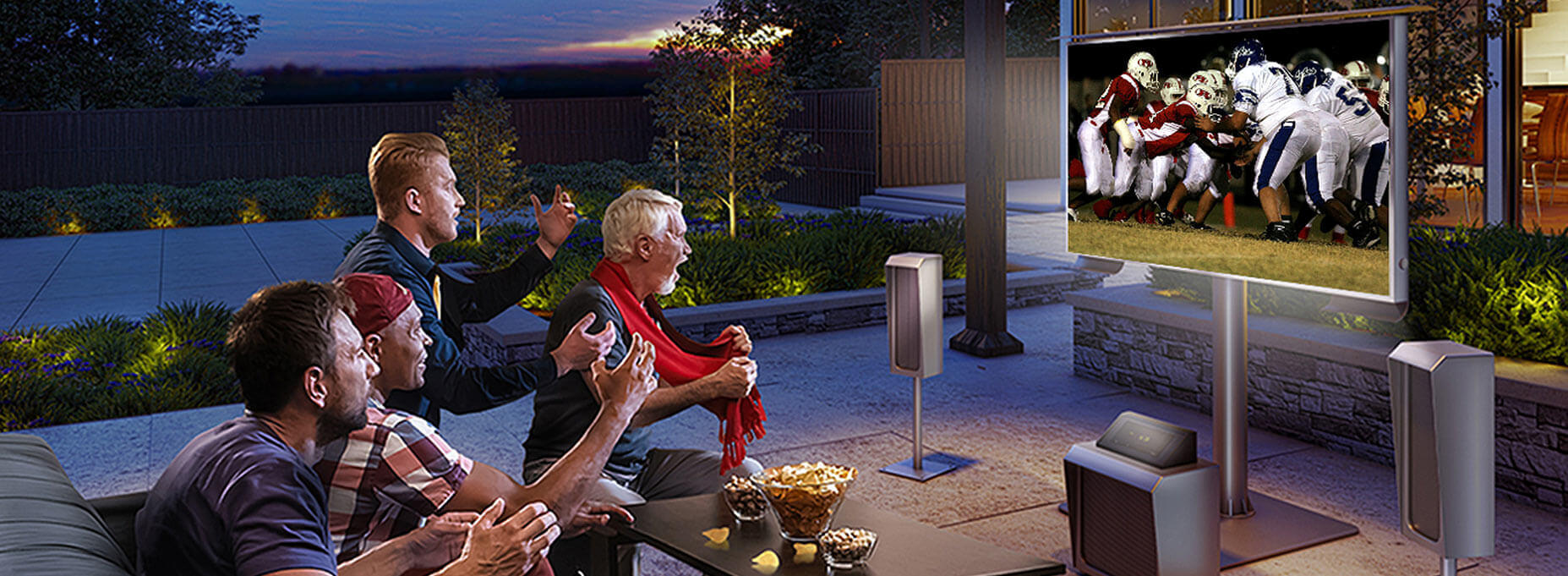 Group of men in a patio watching an American football in a cool looking outdoor TV with its speakers and subwoofers.