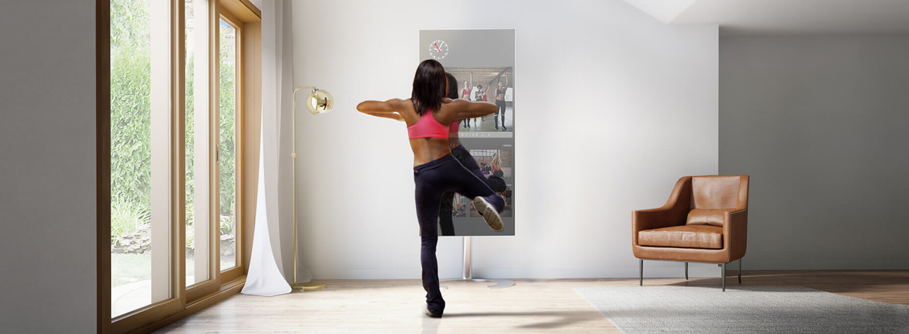 A woman in workout clothes having her workout class online through the use of smart fitness TV in the comfort of her home.